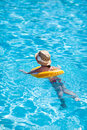 Little girl at swimming pool with inflatable ring Stock Image