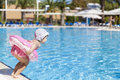 Little girl at swimming pool jumping to the Stock Image