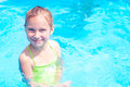 Little girl in swimming pool smiling Stock Photo