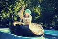 Little girl swims by boat Royalty Free Stock Photo