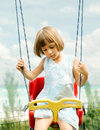 Little girl on a swing Royalty Free Stock Image