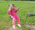 Little girl on swing Royalty Free Stock Image