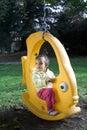 Little Girl on the Swing Stock Image