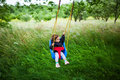 Little girl on a swing field Royalty Free Stock Photo