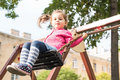 Little girl swinging happy is at playground Royalty Free Stock Photo