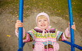 Little girl swinging on park swing view from above Royalty Free Stock Photos