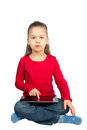 Little Girl with Tablet Computer Sitting with her Legs Crossed Stock Photography
