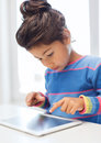 Little girl with tablet pc Stock Image