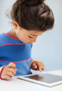 Little girl with tablet pc Stock Images