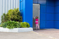 Little girl with tails knocking on steel door Royalty Free Stock Photo