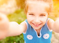 Little girl taken pictures of her self Royalty Free Stock Photo