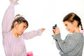 Little girl taking pictures of her sister with camera isolated o Royalty Free Stock Photo