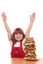 Little girl with tall sandwich happy Stock Images