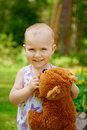 Little girl with teddy bear adorable a Stock Image