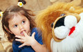 Little girl and teddy lion