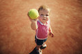 Little girl with tennis ball funny Stock Photo