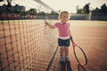 Little girl with tennis racket funny Stock Image