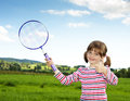 Little girl with tennis rocket Royalty Free Stock Photos
