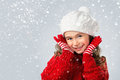 Little girl think about Santa on snow background Royalty Free Stock Photo