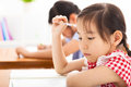 Little girl thinking in the classroom Royalty Free Stock Photo