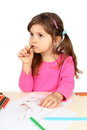 Little Girl Thinking over Drawing Royalty Free Stock Photography