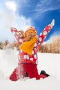 Little girl throw snow happy supper exited throwing in the air on sunny day Royalty Free Stock Photography