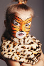 Little girl with tiger costume funny Royalty Free Stock Photography