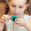 Little girl to sew buttons happy cute Royalty Free Stock Image