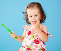 A little girl with a toothbrush Royalty Free Stock Photography