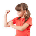 Little girl touches the biceps Royalty Free Stock Image