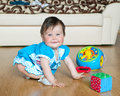 Little girl with toy at home the shallow dof Royalty Free Stock Image