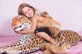 Little girl and toy leopard Stock Photography