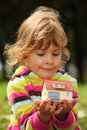 Little girl with toy small house in hands Royalty Free Stock Photo