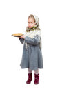 A little girl in traditional slavic kerchief is holding a plate of pancakes shrovetide isolated on white background Stock Images