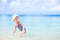 Little girl at tropical beach Stock Photos