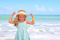 Little girl at tropical beach having fun Royalty Free Stock Images