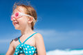 Little girl at tropical beach portrait of cute in a swimsuit Royalty Free Stock Photography