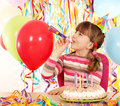 Little girl with trumpet and birthday cake Royalty Free Stock Photo