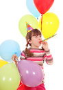 Little girl with trumpet hat and balloons birthday party Royalty Free Stock Photo