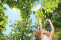 Little girl try to catch heart on a tree Royalty Free Stock Image