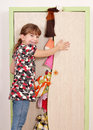 Little girl trying to close closet messy Royalty Free Stock Photos