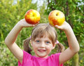 Little girl with two apples Stock Photos