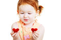 Little girl with two little red heart caucasian lovely symbols in her hands isolated on white background as a valentine card Royalty Free Stock Images
