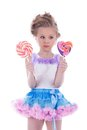 Little girl with two lollipops Royalty Free Stock Image