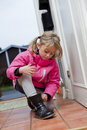 Little girl tying her shoes Royalty Free Stock Photos