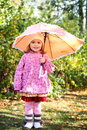 Little girl with umbrella in autumn park Stock Images