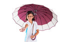 Little girl and umbrella iii malay asian with over white background Royalty Free Stock Photos