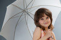 Little girl with umbrella studio shot Stock Photography