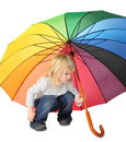 Little girl under a colored umbrella Stock Photography