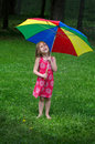 Little girl under colorful umbrella Royalty Free Stock Photo